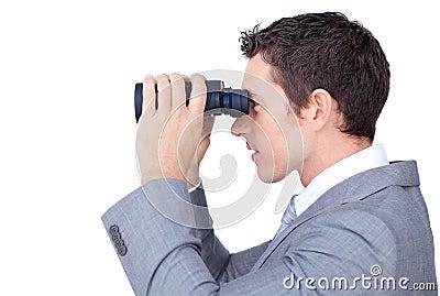 Visionary businessman looking through binoculars