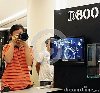 A visitor testing Nikon D800 Editorial Image
