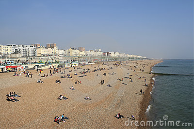 Visitors at the beach in Brighton, UK Editorial Stock Image