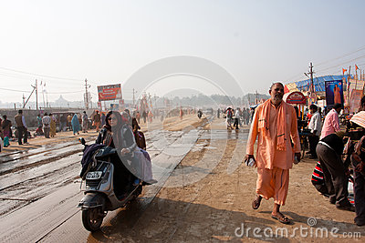 Visitors of the festival Kumbh Mela rushing Editorial Image