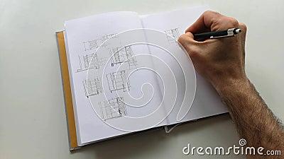 Vista aproximada de um desenho de arquiteto com lápis em papel vídeos de arquivo