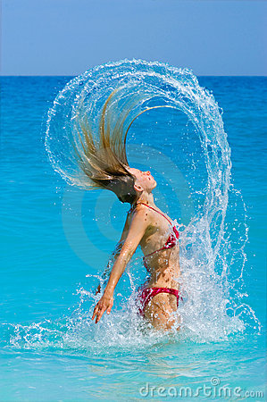 Vital woman jumping out the ocean