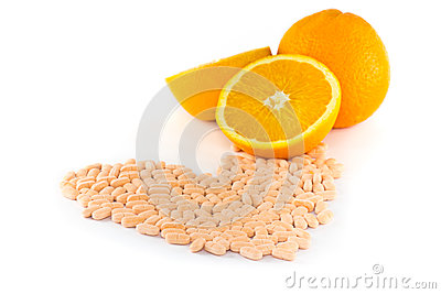 Vitamin c tablet with orange fruit