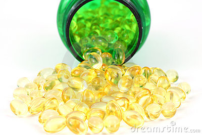 Vitamin D-3 capsules with green pill bottle