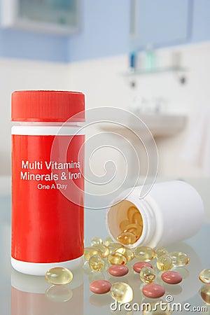 Vitamin pills on bathroom shelf