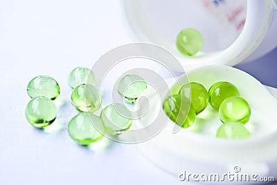 Vitamin pills an pill bottle