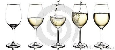 Vitwine som hälls in i ett tomt wineexponeringsglas