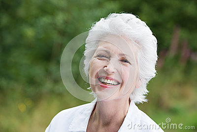 Vivacious laughing senior woman