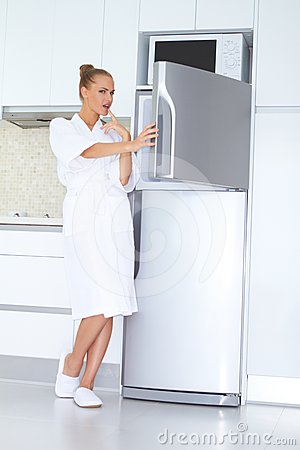 Vivacious woman in bathrobe and slippers
