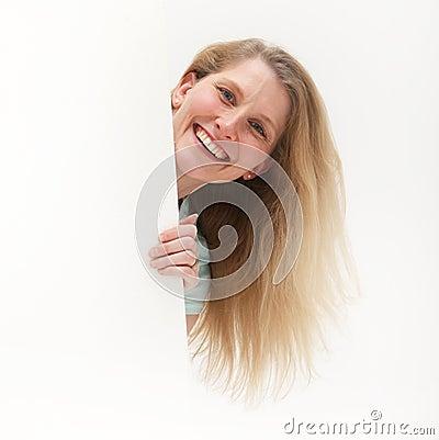 Vivacious woman holding blank poster
