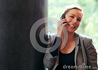 Vivacious woman using a mobile