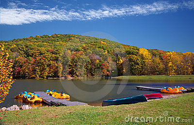 Vivid Autumn Lake Boating Scene