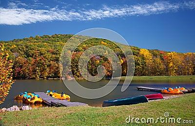 Vivid Autumn Lake Boating Scene