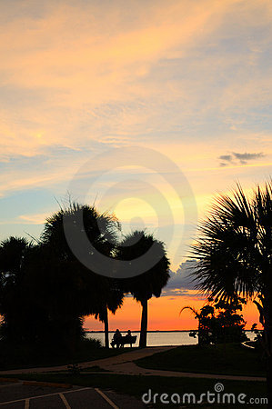 Vivid tropical sunset with couple
