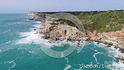 Vliegen over een mooie kust in Mallorca stock footage