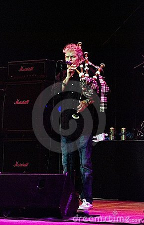 Vocalist Dan Mccafferty playing bagpipes Editorial Photo
