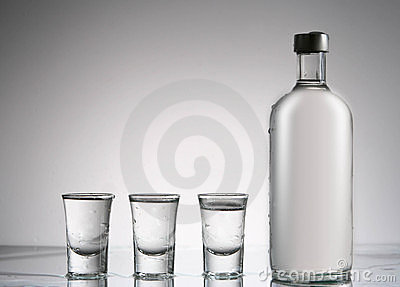 Vodka still bottle and glasses Editorial Stock Image