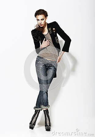 Vogue. Full Length Portrait of Stylish Woman in Informal Pose