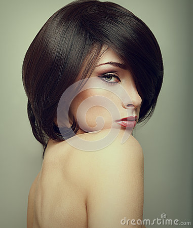 Vogue portrait of alluring woman with short hair