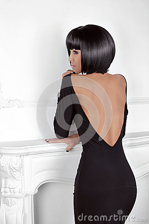 Vogue Style. Fashion Beauty Woman in sexy dress showing back. Br