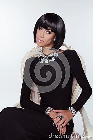 Vogue Style. Fashion Elegant Woman in  black dress.