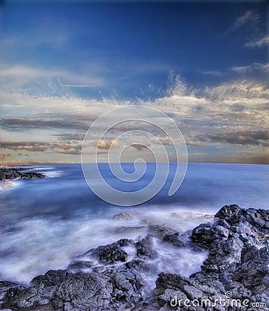 Volcanic stones of Hawaii in the sea
