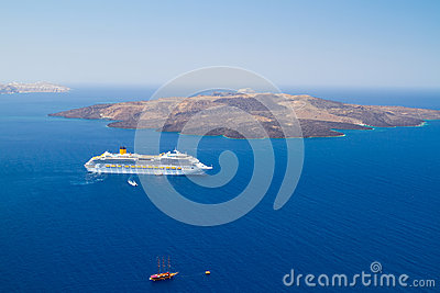 Volcano of Santorini island with ferry