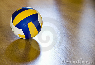 Volleyball on hardwood floor