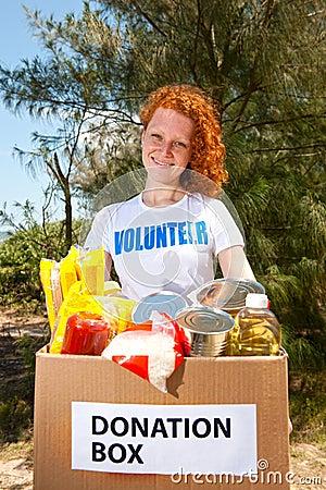 Volunteer carrying food donation box