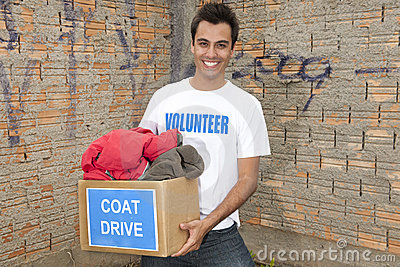 Volunteer with coat drive donation box