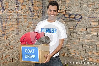 Volunteer with coat drive donation box