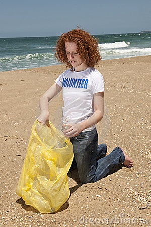 Free Volunteer Collecting Garbage On Beach Stock Photo - 16947920