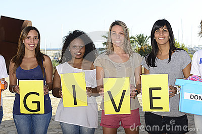 Volunteer group with sign give