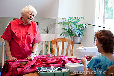 Volunteer helping a senior
