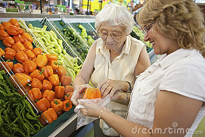 Volunteer helping senior with her shopping