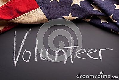 Volunteer sign on a chalkboard
