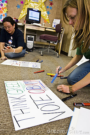 Volunteers making signs Editorial Image