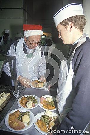 Volunteers serving Christmas dinner Editorial Stock Photo