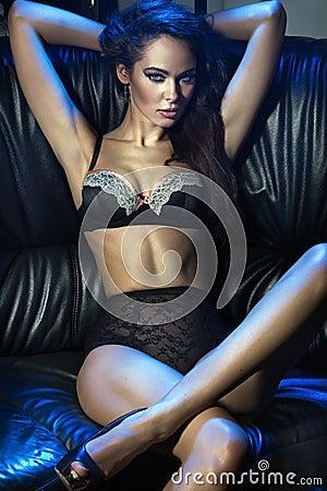 Voluptuous brunette on the sofa