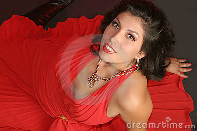Voluptuous girl in red