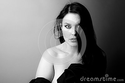 Voluptuous look of brunette young woman.