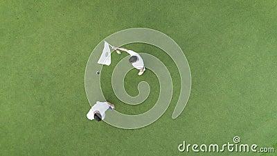 Von der Luftdraufsicht von den Leuten, die Golf im tropischen Luxuserholungsort Punta Cana, Dominikanische Republik spielen