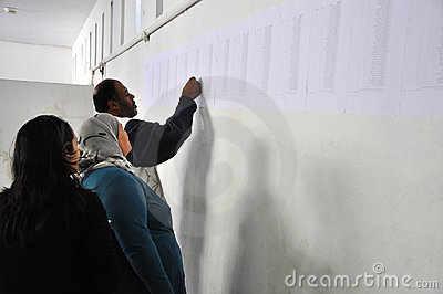 Voters  looking for their names on the list Editorial Photo