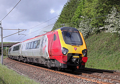 Voyager train on West Coast Main Line in Cumbria. Editorial Stock Photo