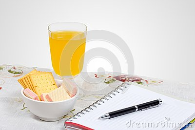 Wafer, cheese crackers and empty note book.