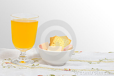 Wafer, cheese crackers and orange juice.