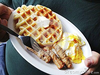 Waffle, sausage, scrambled eggs