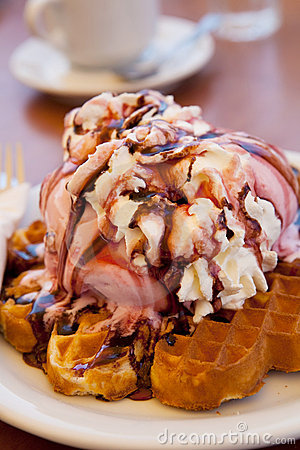 Waffles with ice cream and whipped cream