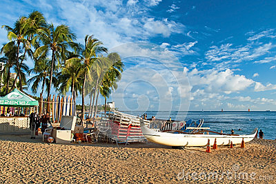 Waikiki beach with a surfs and azure water in Hawaii Editorial Stock Photo