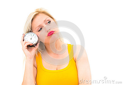 Wait,young beautiful woman holding a clock